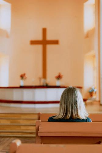 A woman praying in a church